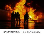 Silhouete Of Firefighters...