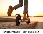 Woman Riding Electric Kick...