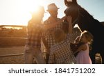 Happy Family With Horse Having...