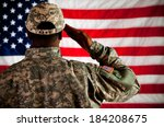 Soldier: Military Man Saluting US Flag - stock photo