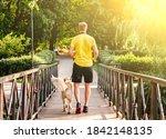 Man Jogging Across Bridge With...