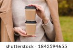 Woman Holds Two Paper Coffee...