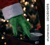 Small photo of A green hairy hand scratches the record