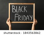 Woman Holding Chalkboard With...