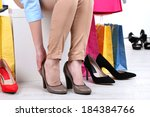 young woman trying on shoes in... | Shutterstock . vector #184384766