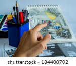 designer works on hand drawing... | Shutterstock . vector #184400702