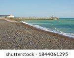 Shingle Beach And Harbour Arm...
