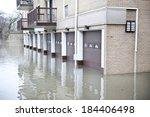a huge flood near an apartment... | Shutterstock . vector #184406498