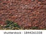 Old Weather Beaten Brick Wall...