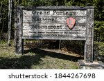 Small photo of Grand Portage, MN/USA - May 29, 2018: grand portage national monument wooden sign