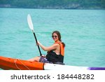 pretty woman with a paddle... | Shutterstock . vector #184448282