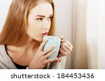 young beautiful woman holding a ... | Shutterstock . vector #184453436