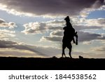 Silhouette Of Man Riding Horse...