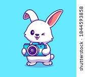 Cute Rabbit Holding Camera...