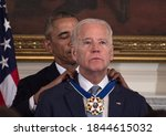 Small photo of US President Barack Obama awards Vice President Joe Biden the Presidential Medal of Freedom during a tribute to Biden at the White House in Washington, DC, USA . 20 Of October 2020.