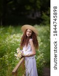 Cute Red Girl In Straw Hat On A ...