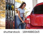 Young Woman Refueling Car At...