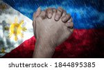 Composite of a hand praying, the Flag of Philippines and rain clouds. Symbolizing heavy rains, storms, typhoons and other bad weather in the country. 3d illustration