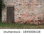 Wooden Door In Old Stone Built...