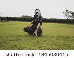 Woman In Halloween Scream Mask...
