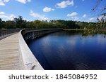 Curving boardwalk over Lake Wilson in North Carolina
