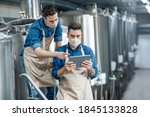Brewery Workers Enter Data At...