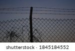 Fence With Barbed Wire Against...