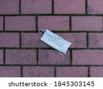 Small photo of Mask thrown to the ground by an uncivil citizen.