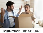 Small photo of Oh dear, what is it? Confused shocked millennial spouses opening delivery with spoiled defective goods products, angry mad clients customers getting their order from online store damaged in shipping