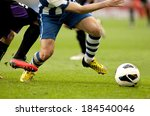 legs of two soccer players vie... | Shutterstock . vector #184540046
