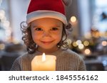 Cheerful Small Girl With Santa...