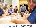 male boss addressing meeting... | Shutterstock . vector #184626782