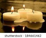 three small tea lights in the... | Shutterstock . vector #184661462