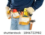 A skilled tradesman stands with his fully loaded tool belt ready to work.  Isolated on white for designer convenience. - stock photo