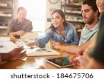 five architects sitting around... | Shutterstock . vector #184675706