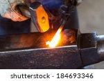 A Blacksmith Forging Hot Iron...