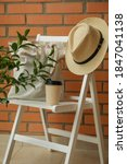 Wooden Chair With Hat  Paper...