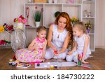 happy mother with two children... | Shutterstock . vector #184730222