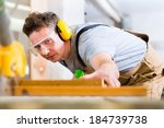 Carpenter Working On An...