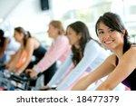 women at the gym doing cardio exercises - stock photo