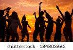 young people dancing on beach... | Shutterstock . vector #184803662