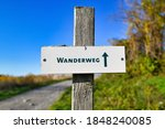 Sign On Wooden Pole Saying ...