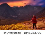 Woman Backpacking On Scenic...