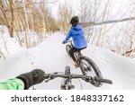 Couple Biking On Fat Bikes On...