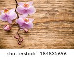 pink orchid on a wooden... | Shutterstock . vector #184835696
