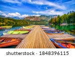 Boat dock on the lake. Lake pier boats. Boats on lake dock. Boats on lake pier