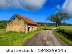 Small photo of Rural abandoned road house view. Abandoned rural house. Abandoned house in rural scene. Abandoned rural house