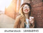 cheerful woman in the street... | Shutterstock . vector #184868945