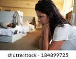 women sitting on beds in... | Shutterstock . vector #184899725