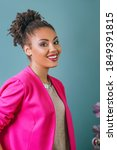 Small photo of portrait of beautiful attractive cheerful smiling young woman (mixed rase) in pink blazer. Love, support, togetherness, care, diversity concept